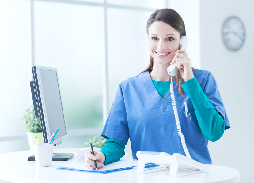 nurse holding a telephone
