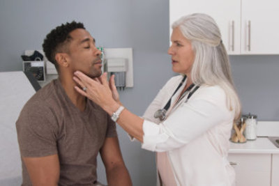 Attractive black male having doctor checkup at health clinic